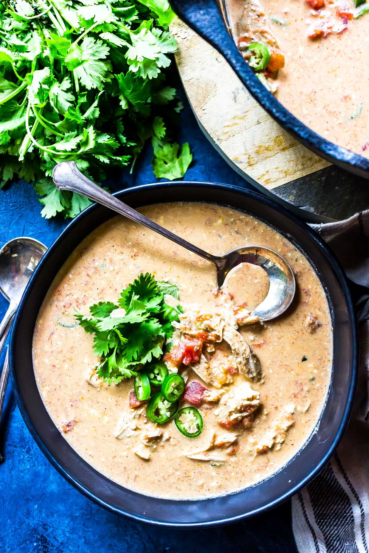 Keto Queso Chicken Soup in bowl topped with cilantro
